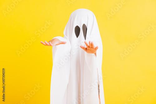 Fotografia, Obraz Funny Halloween Kid Concept, Closeup a little cute child with white dressed cost