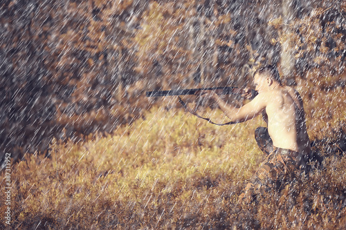 Cuadros en Lienzo man goes hunting forest summer / landscape in the forest, huntsman with a huntin