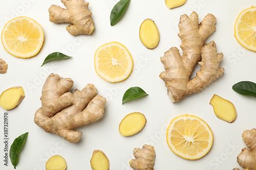 Fresh ginger and lemon on white background, top view Fototapet