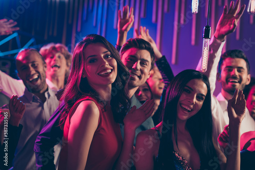 Photo portrait of attractive people dancing together waving hands saying hi at p Canvas