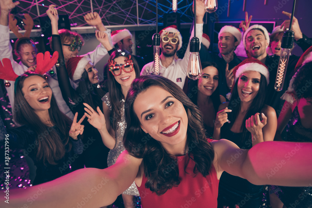 Fototapeta Photo of positive funny people shoot selfie girl show v-sign have fun enjoy dance floor modern club indoors