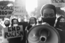 People From Different Culture And Races Protest On The Street For Equal Rights - Focus On Black Man Eyes