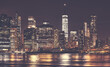 New York City Manhattan downtown skyline at night, color toning applied, USA.