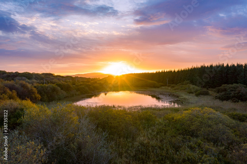 Fotografie, Obraz Aerial of lake in a peatbog by Clooney, Portnoo - County Donegal, Ireland