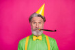 Leinwandbild Motiv Photo of funny white haired grandpa blow noisemaker funky birthday party chilling wear paper cap green shirt yellow suspenders isolated bright pink color background