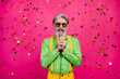 Leinwandbild Motiv Photo of funny grandpa clubber party chill singing karaoke microphone confetti fall rejoicing wear sun specs green shirt yellow suspenders tie isolated shine pink color background