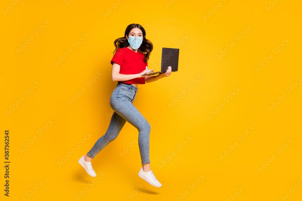 Fototapeta Full length profile side photo of girl work laptop internet sale jump run wear mask t-shirt denim isolated yellow color background