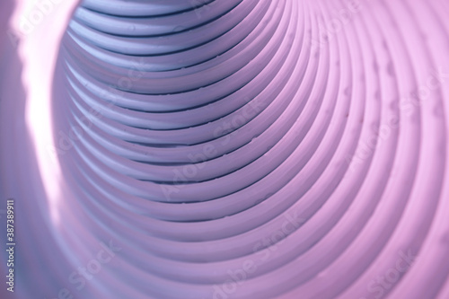 фотография Beautiful round abstract white-gray tunnel with color light on a background pattern textured ford design