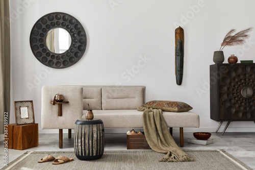 Slika na platnu Modern ethnic living room interior with design chaise lounge, round mirror, furniture, carpet, decoration, stool and elegant personal accessories