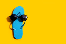 Blue Flip Flops With Sunglasse...