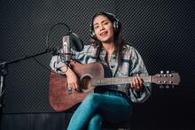 Asian Woman In Music Studio Re...