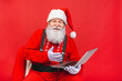 Leinwandbild Motiv Close up photo of funny funky overweight santa claus using laptop search christmas season discounts type congratulations isolated over red background.