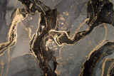 Luxury abstract fluid art painting in alcohol ink technique, mixture of black and gold paints. Imitation of marble stone cut, glowing golden veins. Tender and dreamy design