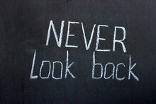 Text On A Dark Board Never Look Back. Motivational Lettering
