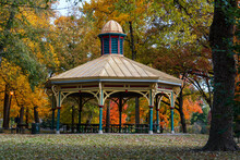 Gazebo In Park During Fall And Autumn Changing Of Leaves