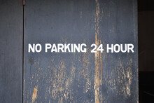 No Parking Sign On Old Wooden ...