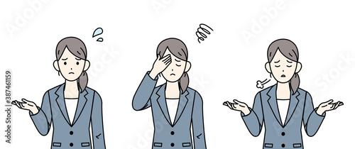 Obraz na płótnie ビジネスウーマン 会社員 肩をすくめる 困る ネガティブな感情
