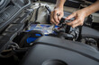 Engine engineer is replacing car battery because car battery is depleted. concept car maintenance And the cost of car care.
