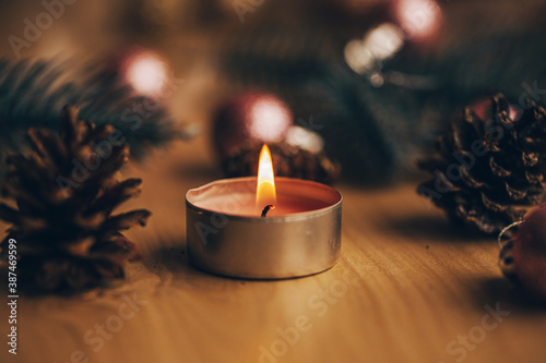 Papel de parede Tea light candles lit with flame. Christmas time. Bokeh. Light.