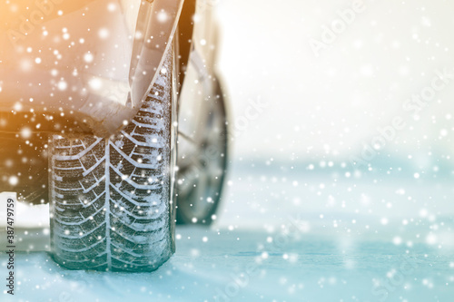 Obraz Close-up of car wheels rubber tires in deep winter snow. Transportation and safety concept. - fototapety do salonu