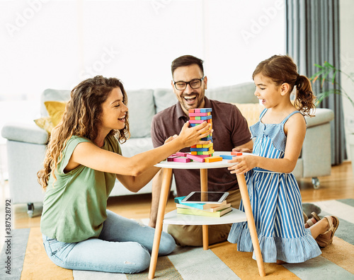 Obraz na plátně child daughter family happy mother father board game palying playing fun togethe