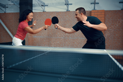 Man and woman play table tennis, ping pong players