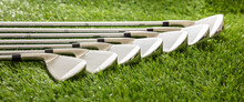 Golf Sticks On Green Grass Golf Course, Close Up View.