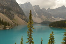 The Turquoise Moraine Lake And The Waterfalls And Nature Of The Rocky Mountains In British Columbia, Canada