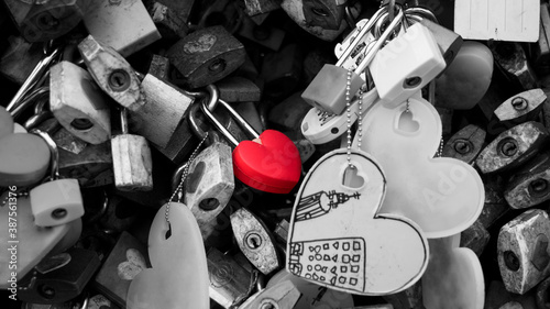 Fotografie, Obraz Heart-shaped love key - conveys deep true love, which is as tenacious as the padlock