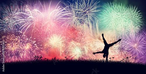 Fotografie, Obraz Happy man celebrate firework party on new years eve.
