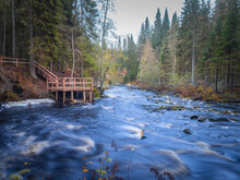 Rivers Of Karelia. Òature Of Northern Russia. Fast Flowing River. River In Middle Of Karelian Forest. Concept Excursions In Forests Of Karelia. Wood Platform By Forest River. Òour Of  Regions Russia.