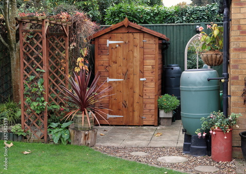 Fotomural Garden Shed with water Butts