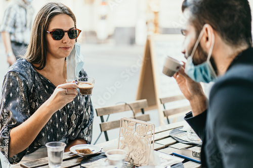 Photo couple having an espresso coffee in new normal coronavirus time