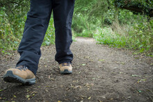 Woman In Walking Boots Hiking UK Countryside