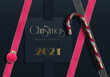 Holiday New Year 2021 card. 3D realistic Xmas candy cane, gold digit 2021, pink ribbons, Xmas pink balls baubles on blue background. Golden text Merry Christmas Happy New year. Holiday card. 3D render