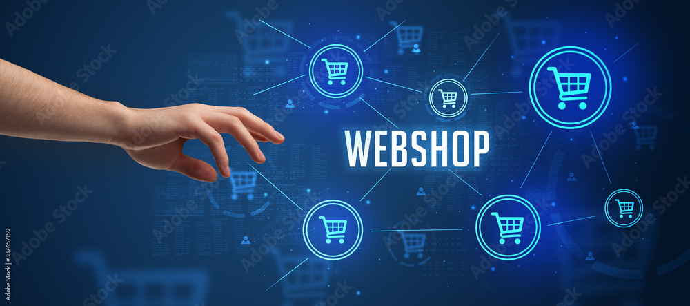 Fototapeta Close-Up of cropped hand pointing at WEBSHOP inscription, online shopping concept