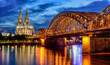 Hohenzollern Bridge and gothic Cathedral in Cologne city, Germany