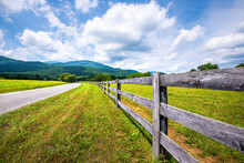 Farm Road Fence Closeup In Roseland, Virginia Near Blue Ridge Parkway Mountains In Summer With Idyllic Rural Landscape Countryside In Nelson County
