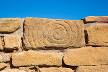Spiral Petroglyph Carved Into The Side Of A Stone Of The Pipe Shrine House In Mesa Verde National Park (Colorado).