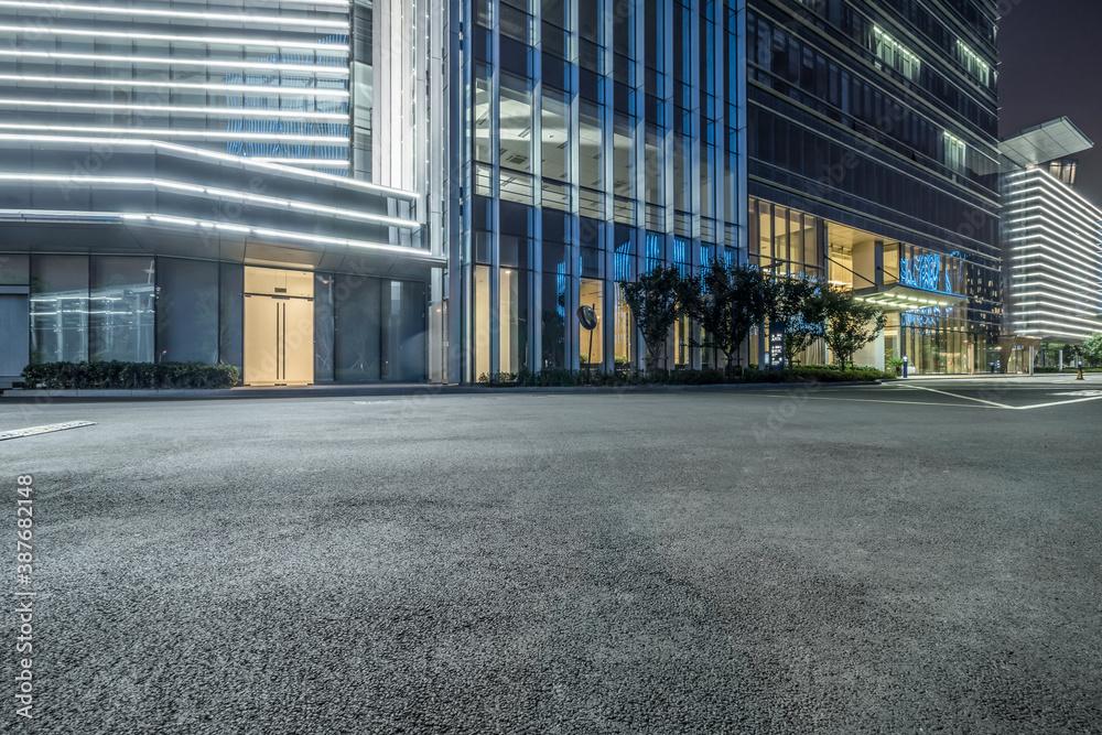 Fototapeta clean asphalt road through office block area, suzhou, china.