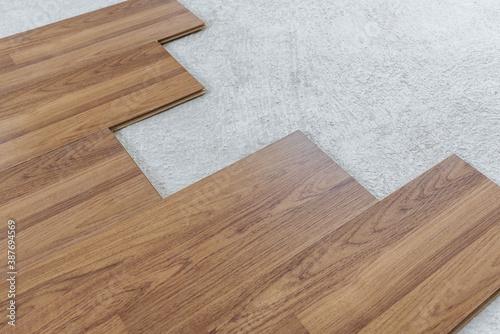 Fototapeta Laminated wood flooring installation and renovation, with base cement floor obraz na płótnie