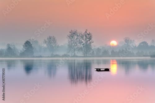 Fototapeta early morning before sunrise over the lake obraz