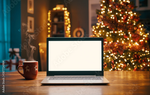 Fototapeta Laptop with blank screen and Christmas tree obraz