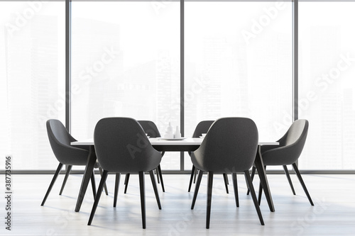 Six black chairs with white kitchen table near a big window with view of the cit Fotobehang