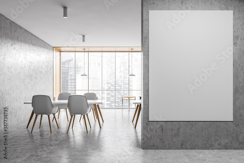 Mockup canvas in a light grey office, white tables and chairs on marble floor Canvas