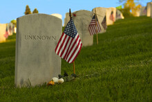 An American Flag Stands Beside The Grave Of An Unknown Service Member In The National Cemetery In Los Angeles