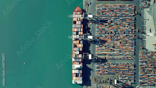 Fotografiet trade, ships and containers looking down aerial view from above, bird's eye view