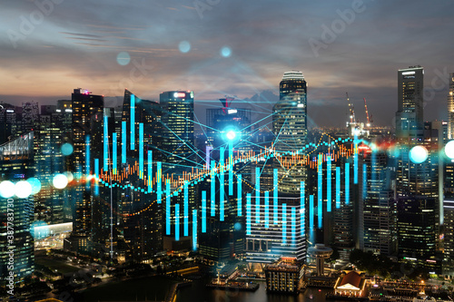 Obraz Glowing FOREX graph hologram, aerial panoramic cityscape of Singapore at sunset. Stock and bond trading in Asia. The concept of fund management. Double exposure. - fototapety do salonu