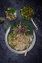 Vegan Indian Cumin Rice With Okra And Pickled Onions On Banana Leaf And Traditional Silver Platter