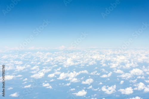 Light rare cumulus good weather clouds on a summer day, panorama view from a height Canvas Print